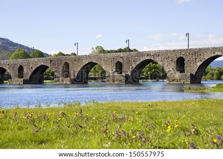 roman bridge of Ponte de Lima in Portugal - stock photo