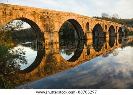 Roman bridge of Ponte do Porto at sunset in Braga, the north of Portugal - stock photo