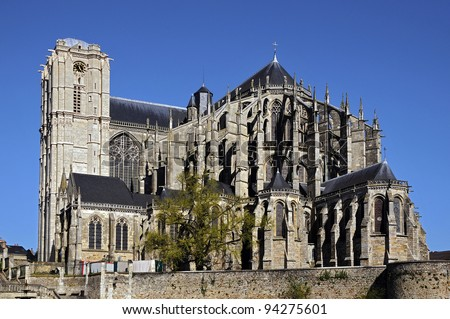 Roman cathedral of Saint Julien at Le Mans on blue sky background, Pays de la Loire region in north-western France - stock photo