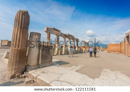 Roman city of Pompeii, which was destroyed and buried by ash during the eruption of Mount Vesuvius (Vesuvius in the background) in 79 AD - stock photo