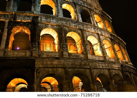 Roman Coliseum by night with Illuminated arches, Rome Italy - stock photo
