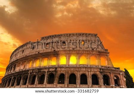 Roman Colosseum at sunset. - stock photo