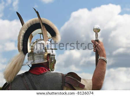Roman Conqueror holds staff up to the Sky - stock photo