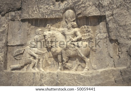 Roman Emperor Valerian submits to Persian King Shapur, wall carving,		Naqsh-e Rustam	Iran