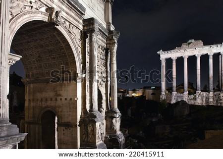 Roman Forum by night Arch of Titus, Temple of Saturn in Rome - stock photo