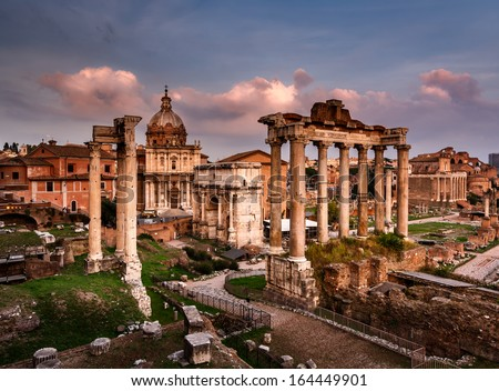 Roman Forum (Foro Romano) and Ruins of Septimius Severus Arch and Saturn Temple at Sunset, Rome, Italy - stock photo