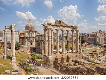 Roman Forum - Forum (Square) in the heart of ancient Rome with the surrounding buildings. Italy. - stock photo
