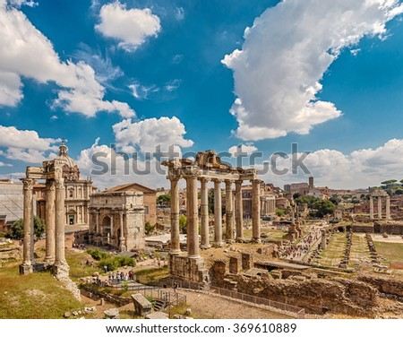 Roman Forum, in the center - the columns of the Temple of Saturn, followed by the Arch of Septimius Severus. Rome. Italy.  - stock photo