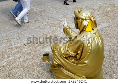 ROMAN FORUM, ROME- APRIL 19: A street artist performs for tourists in the historical center of Rome, April 19, 2011 in Rome, Italy. - stock photo