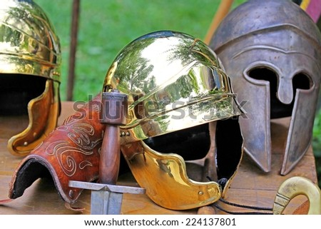 roman helmets and medieval helmets of brave knights and soldiers - stock photo
