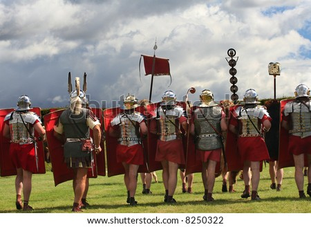 Roman Legion Marches on to War with swords drawn under Stormy Skies in Northumberland, England - stock photo