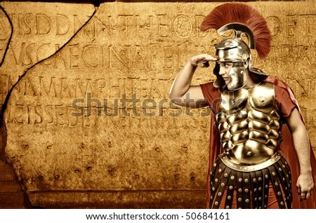 Roman legionary soldier in front of abstract wall