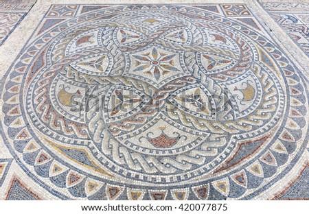 Roman mosaic in ancient Volubilis, Morocco - stock photo