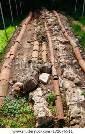 Roman plumbing excavation in Gonio fortress, Georgia  - stock photo