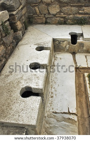 Roman public toilet. Turkey, Ephesus. Sumer time.