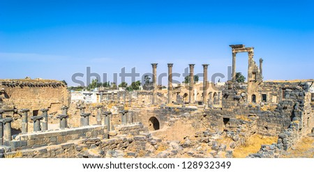 Roman ruins north of the citadel. City of Bosra, Syria. UNESCO world heritage - stock photo