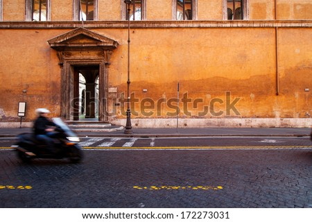 Roman scooter with motion blur, Rome Italy  - stock photo