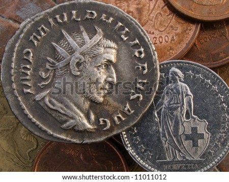 Roman silver Antoninianus coin, showing Emperor Philip I, Rome 245-247AD, looking at figure of Helvetia on modern Swiss Franc - stock photo