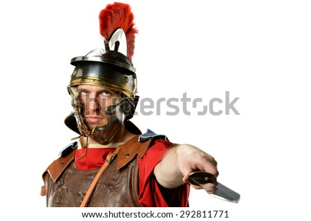 Roman soldier brandishing sword isolated over white background - stock photo