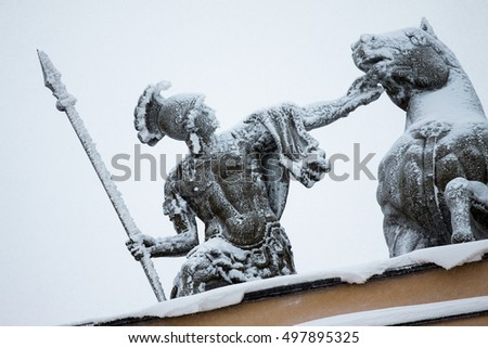 Roman soldier covered snow - detail of the chariot of victory over the arch of the General Staff in St. Petersburg