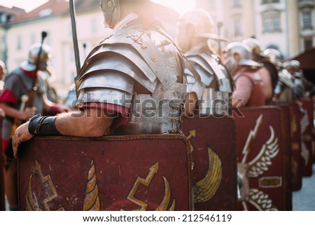 Roman soldiers legionaries standing at ease  - stock photo