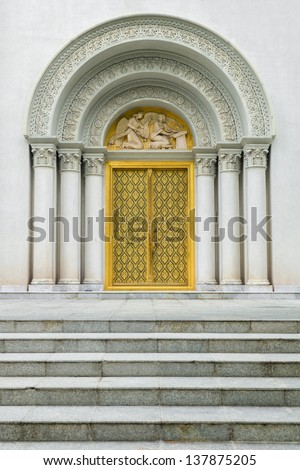 Roman style gate of the grand entrance to the church in Thailand - stock photo