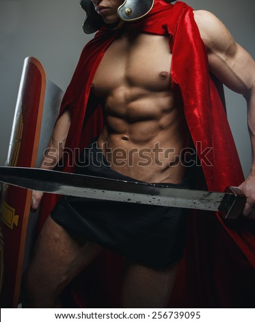 Roman warrior with sword and shield isolated on grey. - stock photo