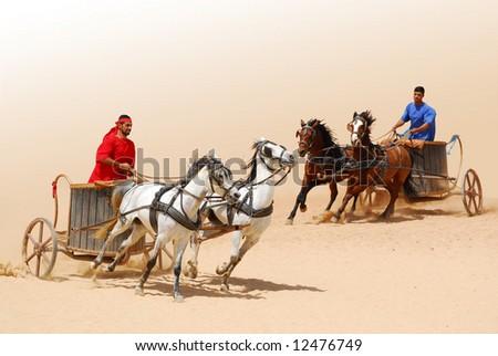 Roman warriors racing with horses and chariots carts during Roman show in Jerash, Jordan - stock photo