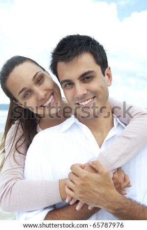 romance on vacation: portrait of a couple in love - stock photo