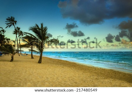 Romanctic view of sunrise on the exotic beach of Caribbean Sea. - stock photo