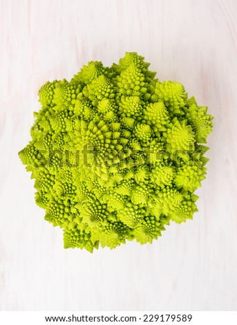 Romanesco cabbage head on white wooden background, top view - stock photo