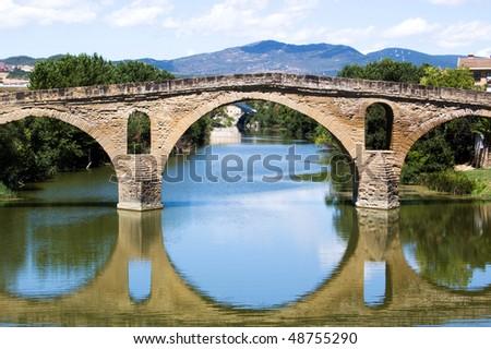 romanesque bridge At Puente la Reina - stock photo