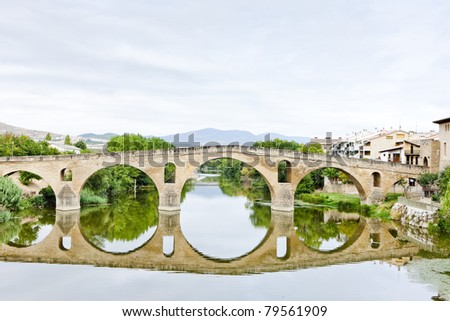 romanesque bridge over river Arga, Puente La Reina, Road to Santiago de Compostela, Navarre, Spain - stock photo
