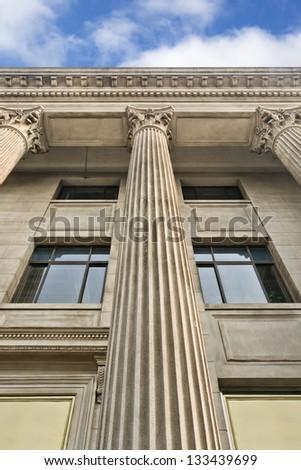 Romanesque building with ornamental pillars - stock photo