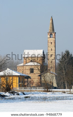 Romanesque church in winter time, ancient stage in the medieval pilgrimage route to Rome