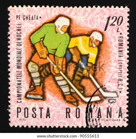 ROMANIA - CIRCA 1970: A stamp printed in Romania (catalogue number Scott 2008 2150) shows image of two ice hockey playersa with a puck, circa 1970