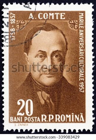 ROMANIA - CIRCA 1958: A stamp printed in Romania issue shows Auguste Comte philosopher, death centenary, circa 1958. - stock photo
