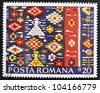 ROMANIA - CIRCA 1975: A stamp printed in Romania, show Romanian Peasant Rugs, circa 1975. - stock photo