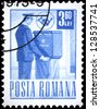 "ROMANIA - CIRCA 1971: A stamp printed in Romania shows a Mail collector, without inscription, from the series ""Postal and transport"", circa 1971 - stock photo"