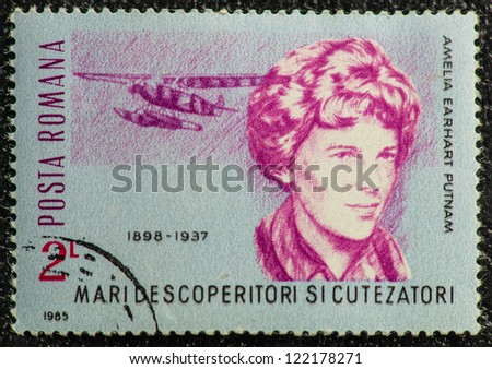 ROMANIA - CIRCA 1985: A stamp printed in Romania shows Amelia Earhart Putnam, first woman who flew solo across the Atlantic Ocean in 1928, circa 1985 - stock photo