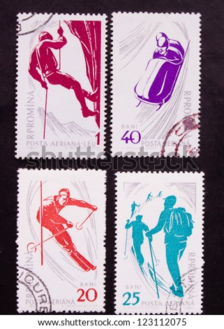 ROMANIA - CIRCA 1961: A stamp printed in Romania shows four different kind of sports  the snowy mountains, circa 1961. - stock photo