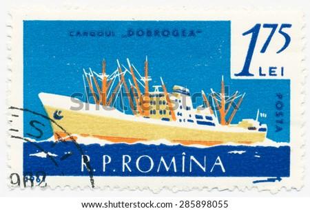 ROMANIA - CIRCA 1961: A stamp printed in Romania shows Freighter Dobrogea, circa 1961 - stock photo