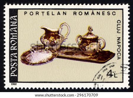 ROMANIA - CIRCA 1992: A stamp printed in Romania, shows Jug, Plate, Tray and Bowl, with inscription and name of series â??Romanian Porcelain from Cluj Napocaâ?, circa 1992 - stock photo