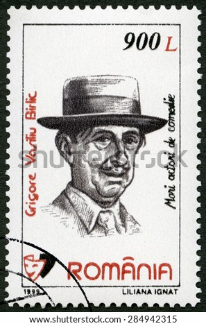 ROMANIA - CIRCA 1999: A stamp printed in Romania shows portrait of Grigore Vasiliu Birlic (1905-1970), series Comic Actors, circa 1999 - stock photo