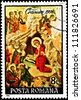 ROMANIA - CIRCA 1991:  A stamp printed in Romania shows the Nativity Scene with Jesus, Mary, Joseph, the Three Kings, and some angels, circa 1991. - stock photo