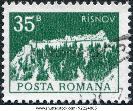 ROMANIA - CIRCA 1973: A stamp printed in the Romania, depicts Rasnov Citadel, circa 1973 - stock photo