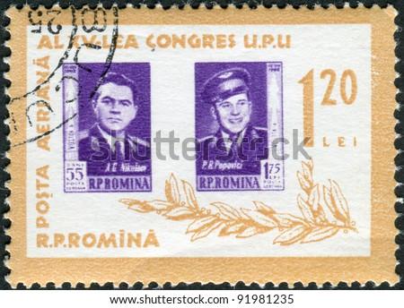 ROMANIA - CIRCA 1963: A stamp printed in the Romania, portrayed Soviet cosmonauts Andriyan Nikolayev and Pavel Popovich, circa 1963 - stock photo