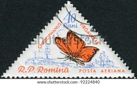 ROMANIA - CIRCA 1960: A stamp printed in the Romania, shows a butterfly Satyrium (Chrysophanus Virgaureae), circa 1960 - stock photo