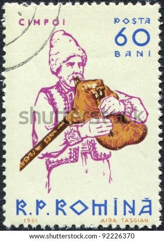 ROMANIA - CIRCA 1961: A stamp printed in the Romania, shows a musical instrument Bagpipes, circa 1961 - stock photo