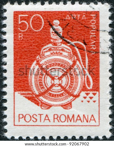 ROMANIA - CIRCA 1982: A stamp printed in the Romania, shows a wooden flask from Suceava, circa 1982 - stock photo